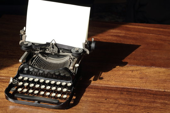 Vintage typewriter on wooden desk contact me