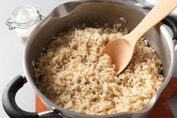 Prepared brown rice in saucepan