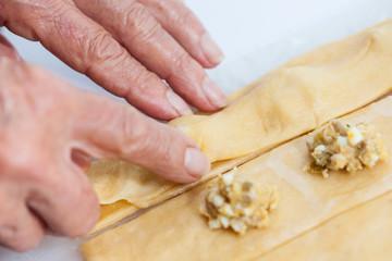 Ravioli Preparation : Placing the upper dough strip to seal the ravioli