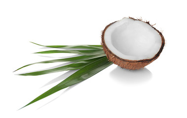 Coconut and palm leaf on white background