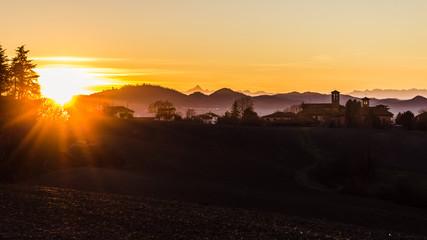 Winter scene.  Golden hour in the Monferrato hills. Piedmont, Italy. Monviso in the background.