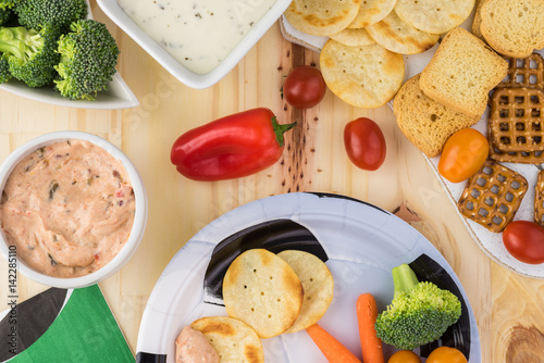 party table for soccer game with variety of snacks and dips stock