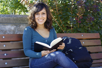 Female Latino college student on campus