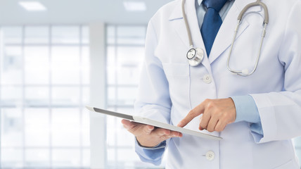 Doctor using a digital tablet computer in hospital. Healthcare And Medicine Concept.