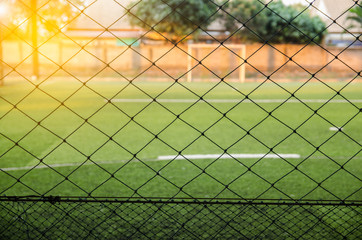 view through a mesh fence artificial turf