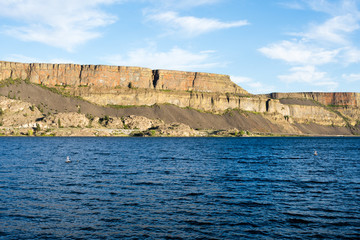 Banks lake and the walls of Grand Coulee in Steamboat Rock state park in Eastern Washington state, USA