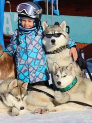 Boy and husky in a ski resort