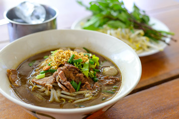 Asian delicatessen, beef noodles with soup.