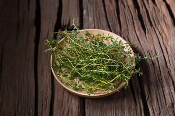 Thyme fresh herb on old wood background