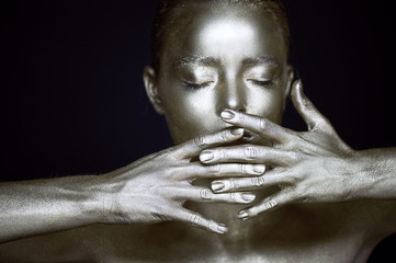 Portrait unearthly silver girls, hands near the face. Very delicate and feminine. The eyes are closed.Frame of hands