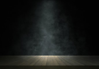 Spotlight and smoke on wooden stage