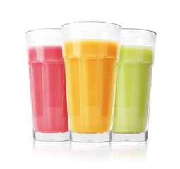 Green, pink and yellow smoothies