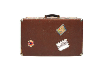 Brown leather suitcase with stickers from travels isolated on white background