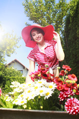 Attractive female gardener with flowers