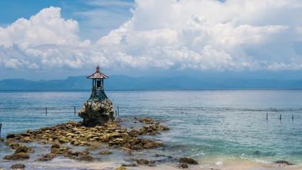 Cute Temple on the Shore by the Sea on Nusa Penida with Dramatic Clouds above Bali, Indonesia