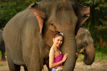 Asian woman wearing traditional thai culture lanna style with elephant ,vintage style,chaingmai Thailand