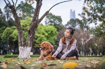 Girl and Golden Retriever, outdoors on the grass