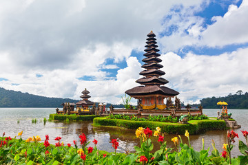Temple Pura Ulun Danu Beratan. Traditional Balinese temple on lake. Place of festivals, famous travel attraction, day tour destination in Bali island, Indonesia. Indonesian people culture background.