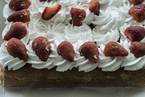 Closeup Of Tres Leches Cake Decorated With Strawberry And Whipped