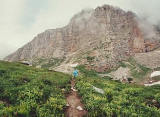 Explorer woman walking near the cliff