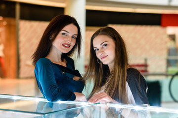 Beautiful girls are shopping at the mall.