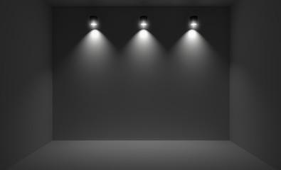 Small room illuminated with three spotlights.