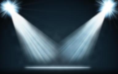 Stage blue spotlights blank background.