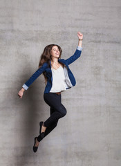 strong businesswoman jump in superhero pose