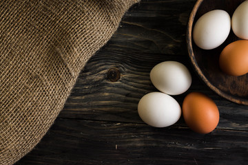 Chicken eggs on a wooden table. Natural product.