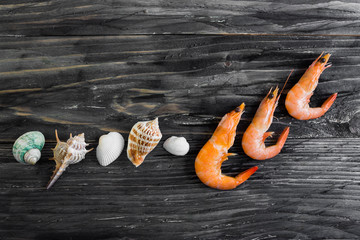 Shrimps on a wooden table in rustic style
