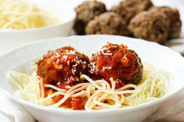 Spaghetti and Meatballs served in a white bowl, selective focus