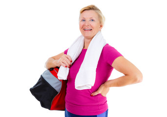 Pensioner woman sport. Happy of Senior old woman with sport bag on shoulder and towel around neck in sport outfit after exercising fitness in gym holding, isolated on white, Positive emotions