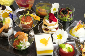 Mini canapes with elements of molecular cuisine on stone