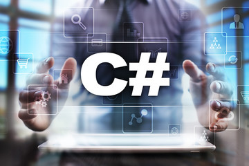 Businessman using tablet pc and selecting c#.