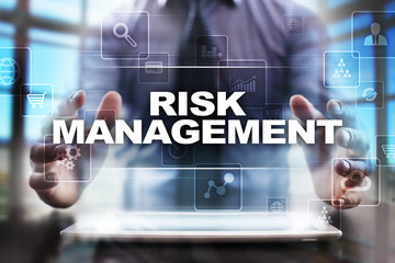 Businessman using tablet pc and selecting risk management.