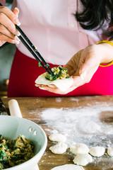Woman making Chinese dumplings