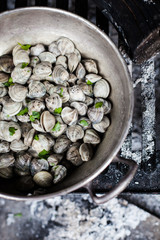 Cooking clams on charcoal burner
