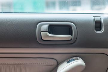 Car door open handle inside with luxury interior