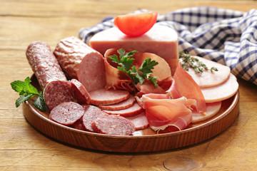 Assortment of meat delicacies (salami, parma, ham)