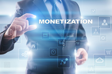 Businessman selecting monetization on virtual screen.