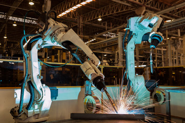 Robots are welding in car factory