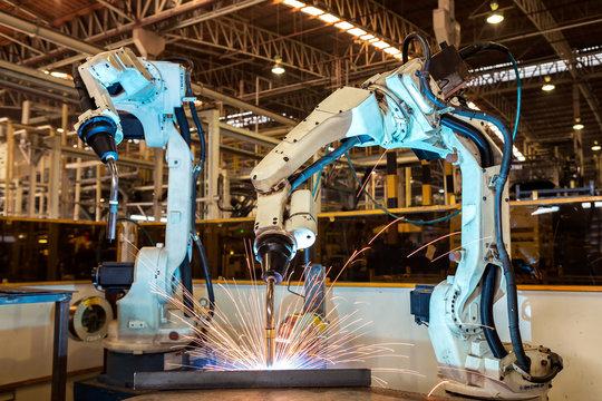 Industrial robots are welding part