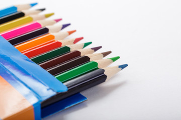 box of colored pencils and sheet of white paper