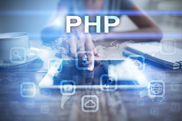 Woman using tablet pc, pressing on virtual screen and selecting php.