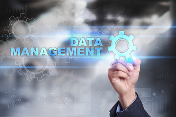Businessman is drawing on virtual screen. data management concept.