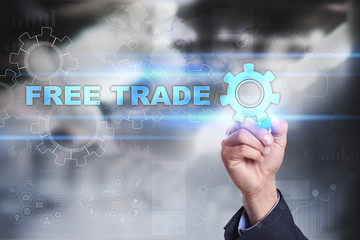 Businessman is drawing on virtual screen. free trade concept.