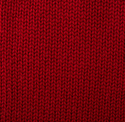 Knitted red woolen fabric background.