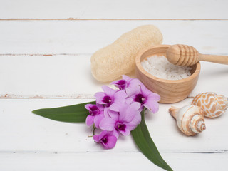 Aromatherapy  product  Spa set ,candle ,soap,coconut orchid flower,shell,  massage  with white wood  background . top view composition.