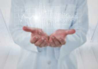 Doctor with white graph and flare in hands against blurry window