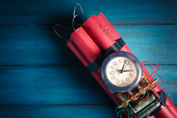 High contrast image of a timebomb on a wooden background